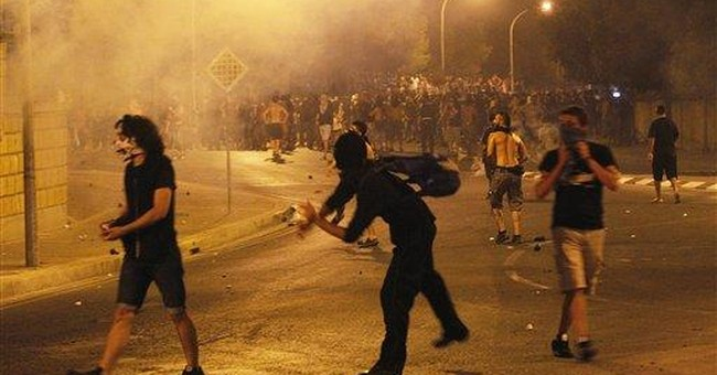 Cyprus police: 20 arrested in base blast protest