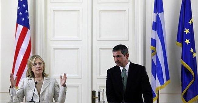 Clinton: US backs tough Greek austerity measures