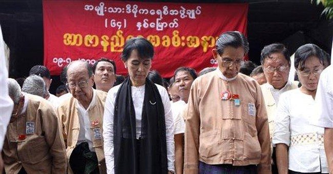 Myanmar's Suu Kyi leads memorial march for father