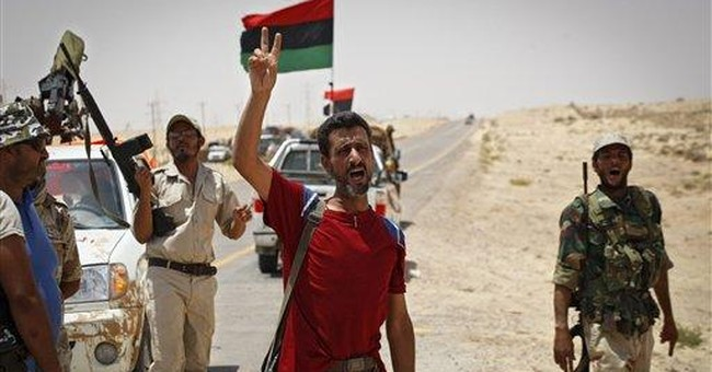 France: Gadhafi could possibly stay in Libya