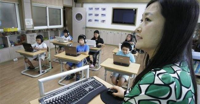 SKorean students ditch paper for digital books
