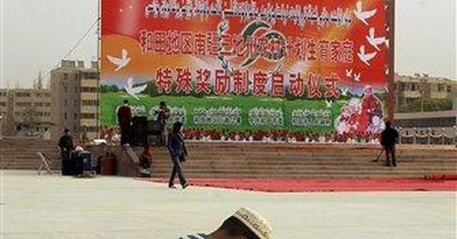 China says 14 extremists killed in Xinjiang attack