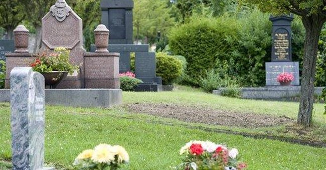 Bones of Hitler deputy exhumed, burned