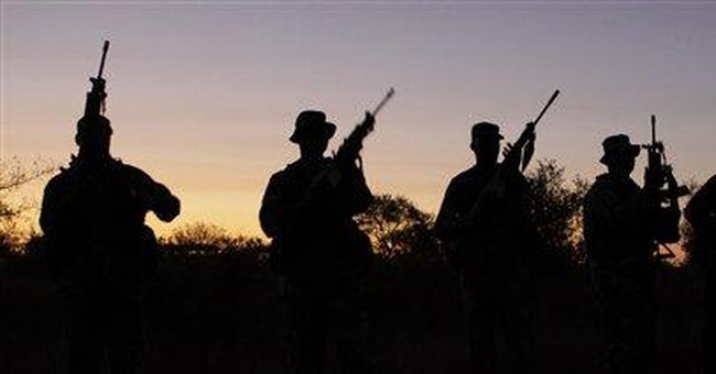 SAfrican troops fight poachers slaughtering rhino
