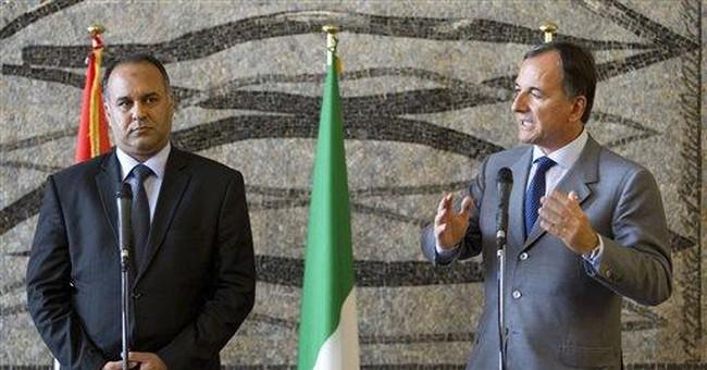 Rebels say Gadhafi must face trial as Tripoli hit