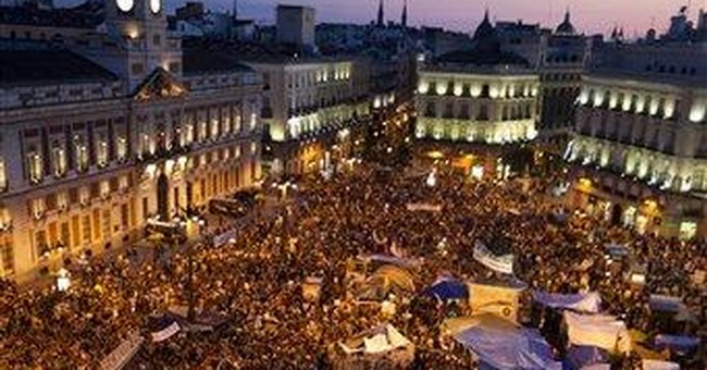 Anti-austerity protesters return to Madrid plaza