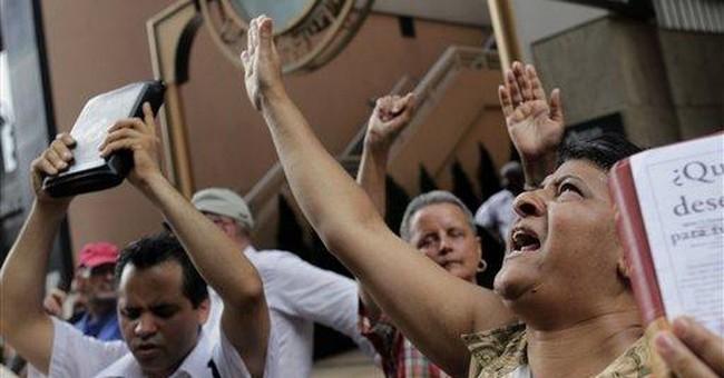 Anti-gay marriage rallies as NY ceremonies begin