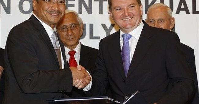 Malaysia, Australia sign refugee exchange pact