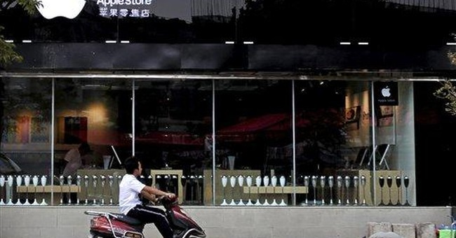 China suspends 2 of 5 fake Apple stores in 1 city