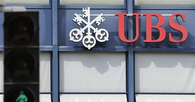 UBS cuts forecasts after profit disappoints in Q2