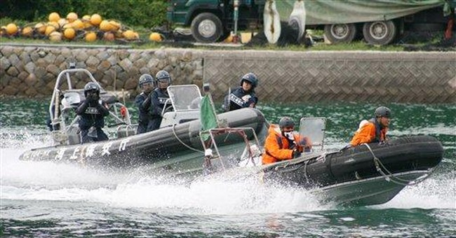 Japanese police practice for dolphin hunt protests