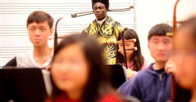 Black teen's unusual talent: Singing Chinese opera