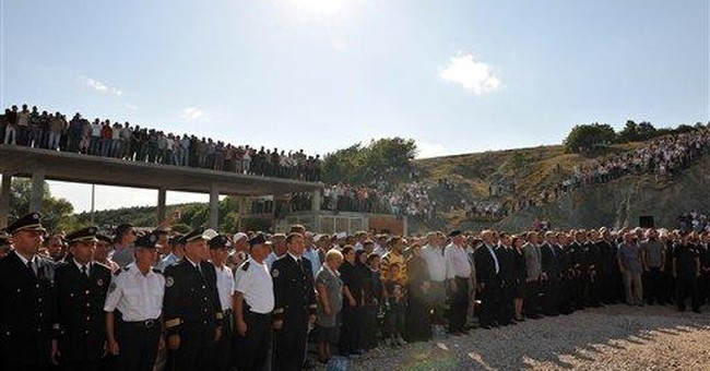 Serb mob sets Kosovo border post on fire
