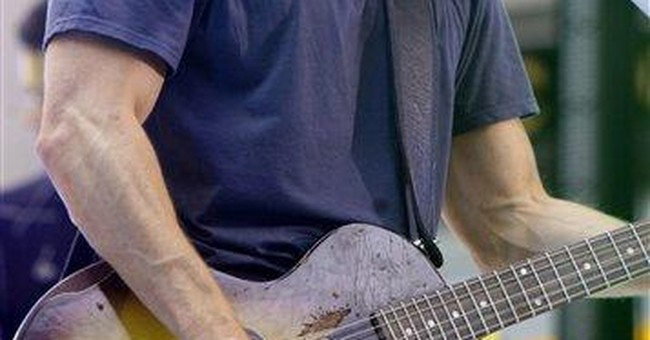 Country star Chesney chugs to touring milestone