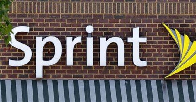 Sprint posts wider loss, teams with LightSquared