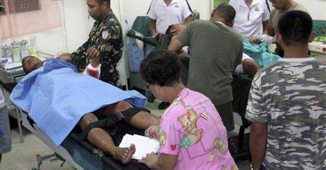 Philippines says militants beheaded 2 marines