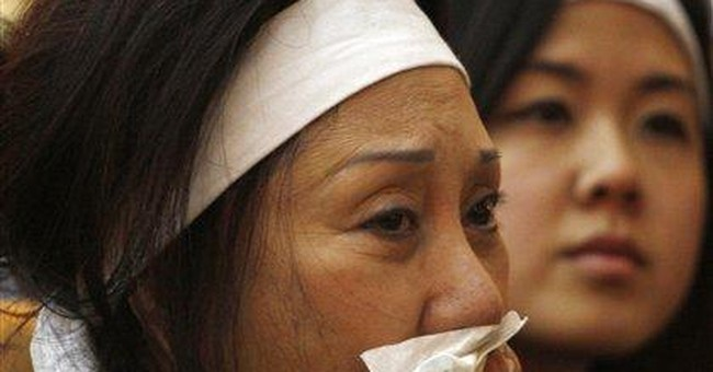 Emotional funeral for South Vietnam's ex-leader Ky