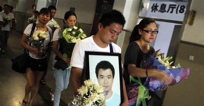 Relatives grieve over China crash as anger lingers