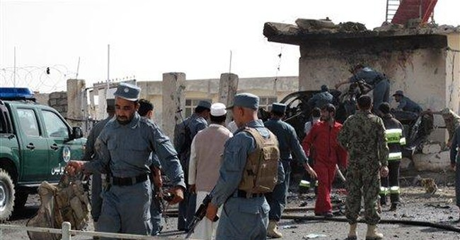 Bomb kills 11 at police HQ in southern Afghanistan