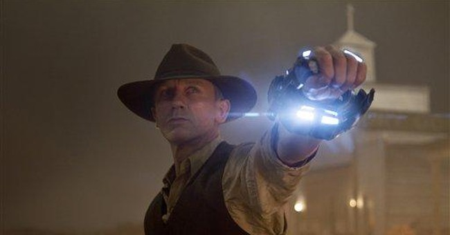 'Cowboys & Aliens' grabs No. 1 spot over 'Smurfs'