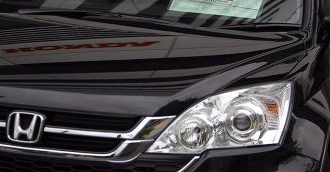 Honda's quarterly profit plunges on disaster