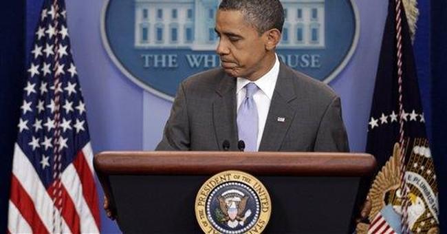 Obama turns 50 amid debt debate