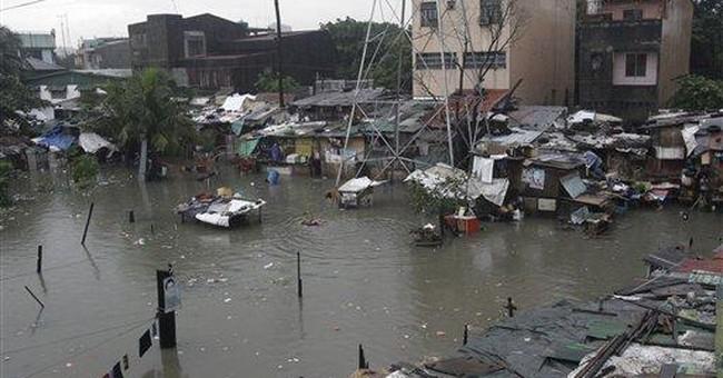 Big floods hit Manila, kill 1, shut schools, work