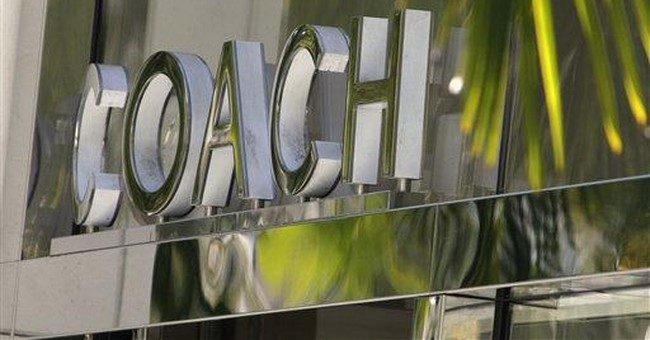 Coach net income rises 4 percent in 4Q