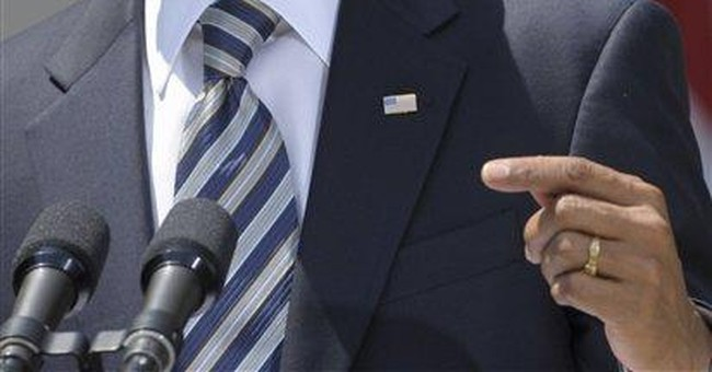 Obama signs legislation to avert default