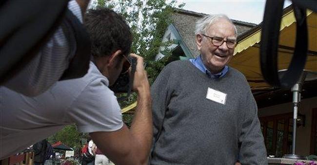 Buffett's company says 2Q profit up 74 percent