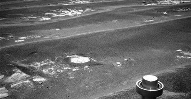 NASA rover reaches rim of big Martian crater