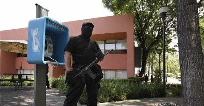 Package bomb injures 2 Mexico college professors