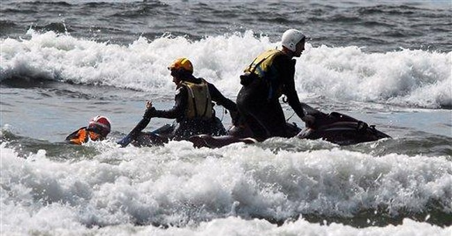 Boy pulled from Pacific surf in dramatic rescue