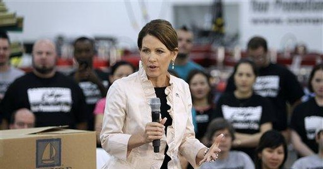 Bachmann points to foster parenting _ on her terms