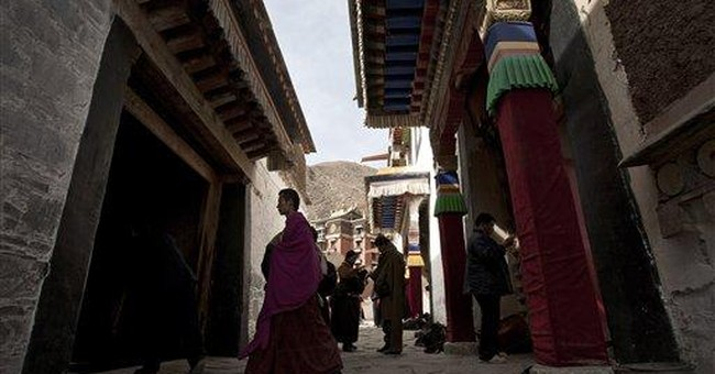 Tibetan monks leery of China-backed lama's visit