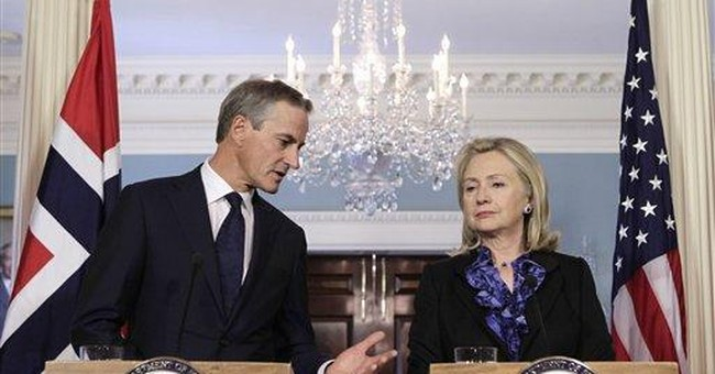 Clinton presses world to shut tap on Syrian oil