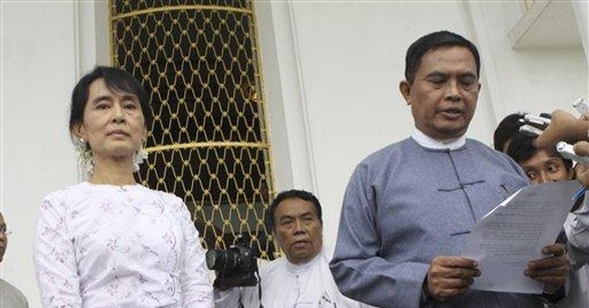 Myanmar government urges Suu Kyi to register party