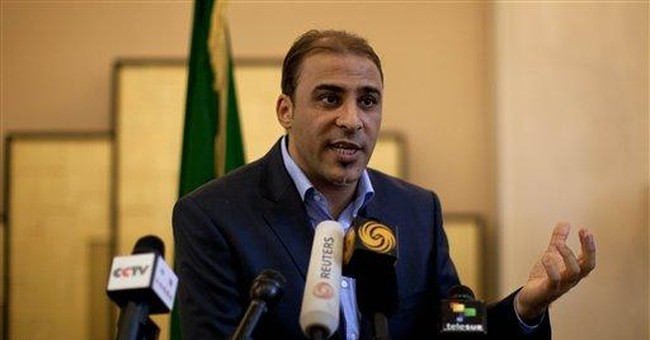 Libyan rebels try to cut routes to Tripoli