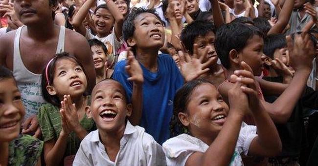 Cheers in Myanmar as Suu Kyi travel tests freedom