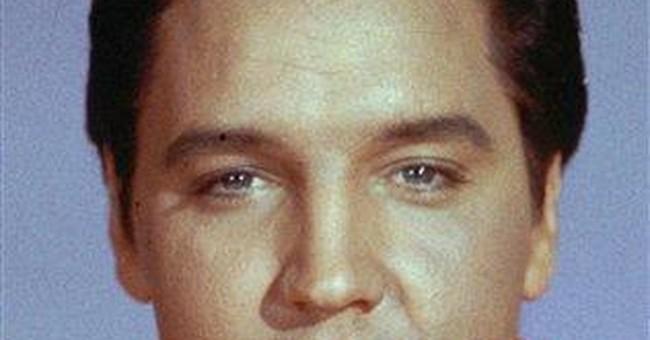 Fans flock to Graceland to remember Elvis Presley