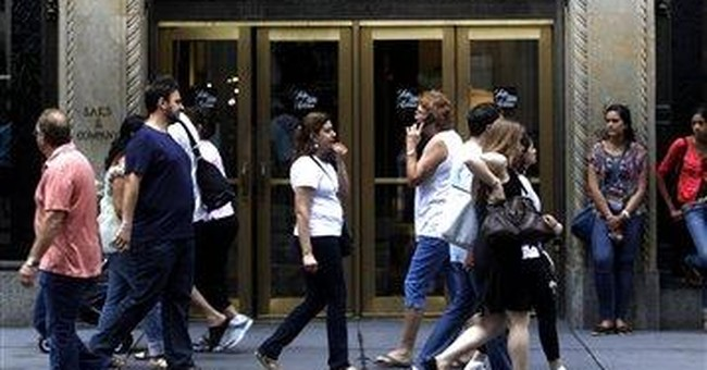 Saks 2nd-qtr loss narrows on full-price selling