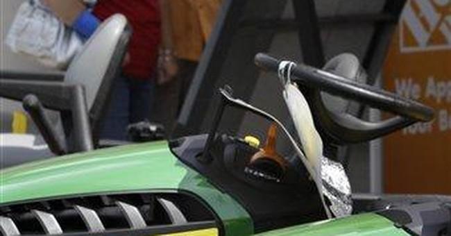 Deere 3Q profit up 15 percent, outlook improves
