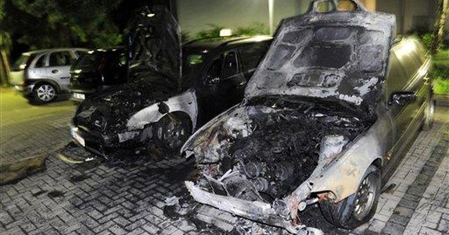 Vandals torch cars in Berlin for 3rd night