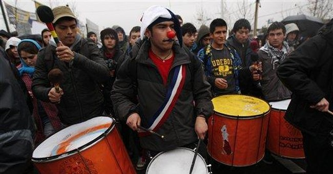 Chileans march in cold rain for education protest