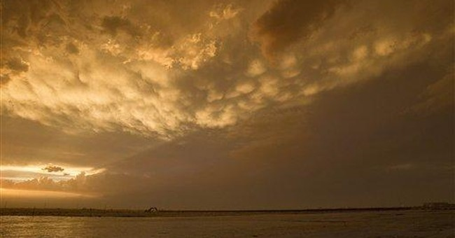 Dust storm envelops Phoenix, downs power lines