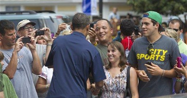 Relaxing Obama hits bookstore, Vineyard golf links