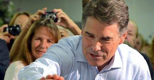 Huntsman pounds Perry on climate change and Fed
