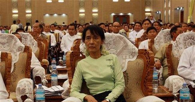 Myanmar's Suu Kyi 'happy' after meeting president
