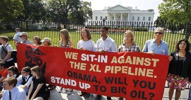 Police arrest 65 near White House in oil protest