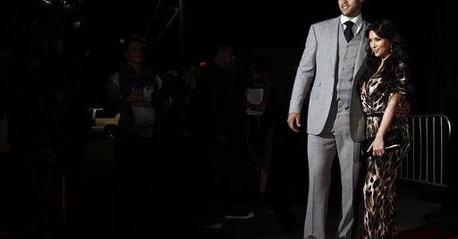 Kardashian, Humphries wed in TV-friendly ceremony